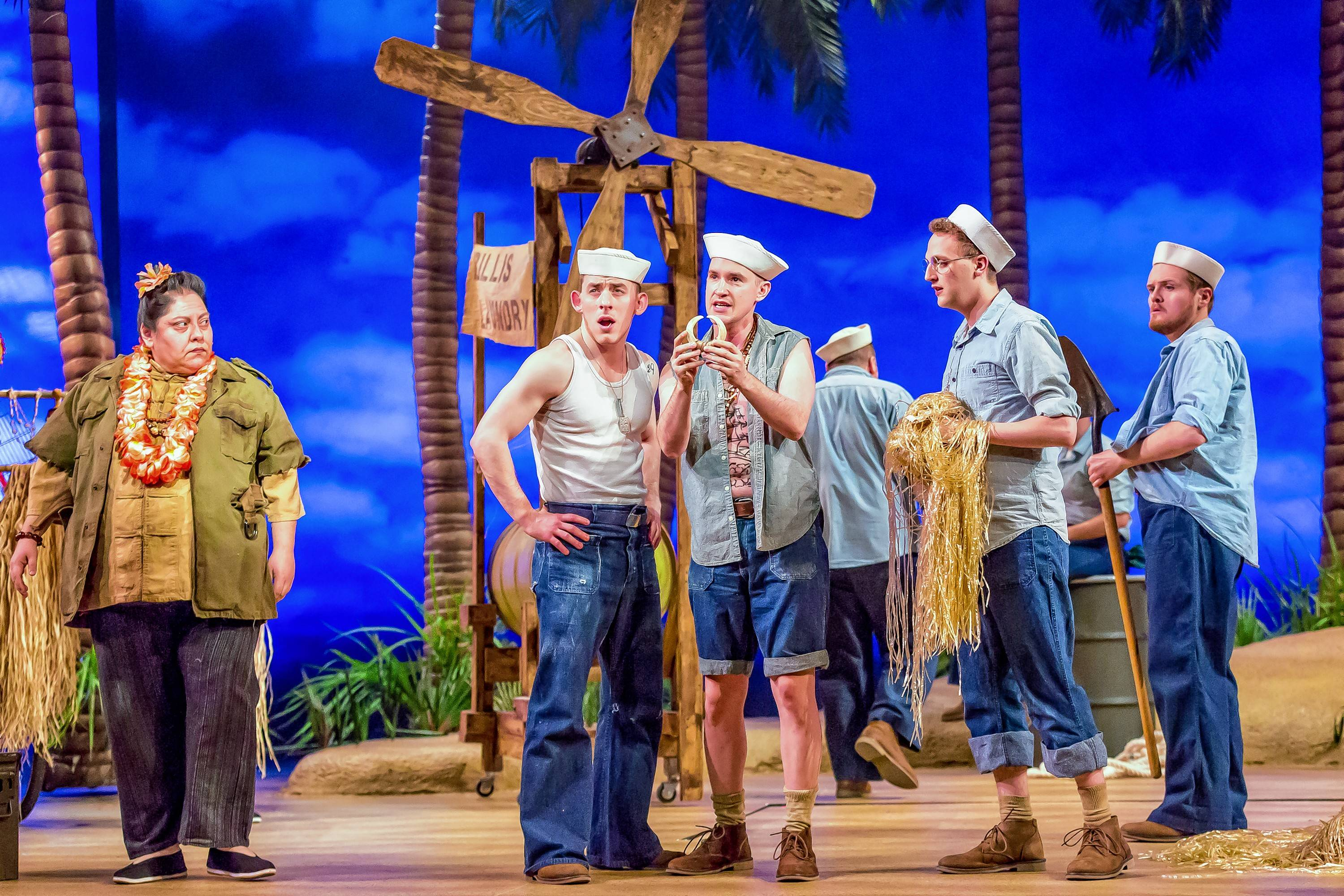 "The merchant Bloody Mary (Yvonne Strumecki) tries to sell items to the U.S. sailors (Joe Capstick, Matt Crowle as ""Luther Billis,"" Sam Shankman as ""Professor"" and Harter Clingman as ""Stewpot"") in Drury Lane Theatre's ""South Pacific."""