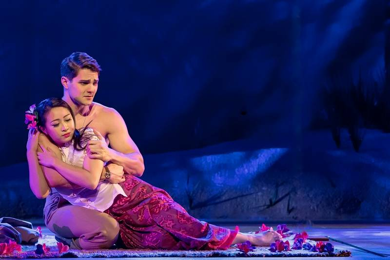 """Lt. Joe Cable (Austin Colby) sings """"Younger Than Springtime"""" to Liat (Sarah Lo) in Rodgers and Hammerstein's """"South Pacific,"""" now playing at Drury Lane Theatre in Oakbrook Terrace."""