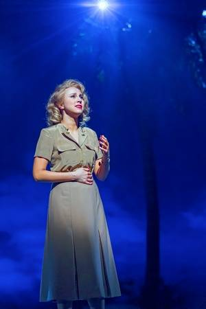 """Ensign Nellie Forbush (Samantha Hill) sings a reprise of """"Some Enchanted Evening"""" in the musical """"South Pacific"""" at Drury Lane Theatre."""