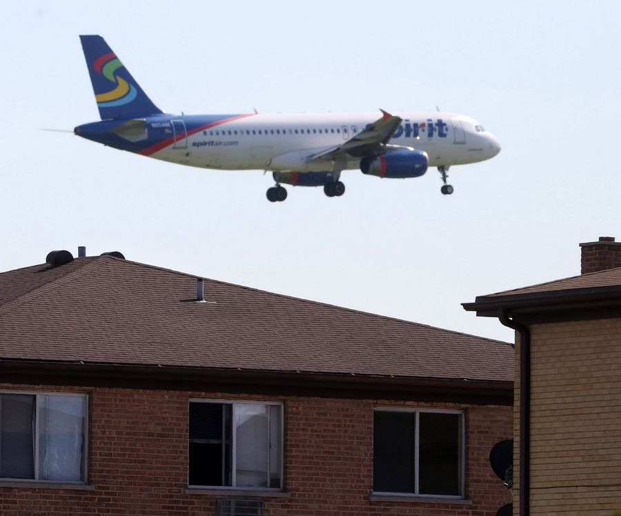 A jet flies over a Bensenville neighborhood. The village is concerned about the slow pace of a western terminal that was supposed to bring an economic boom.