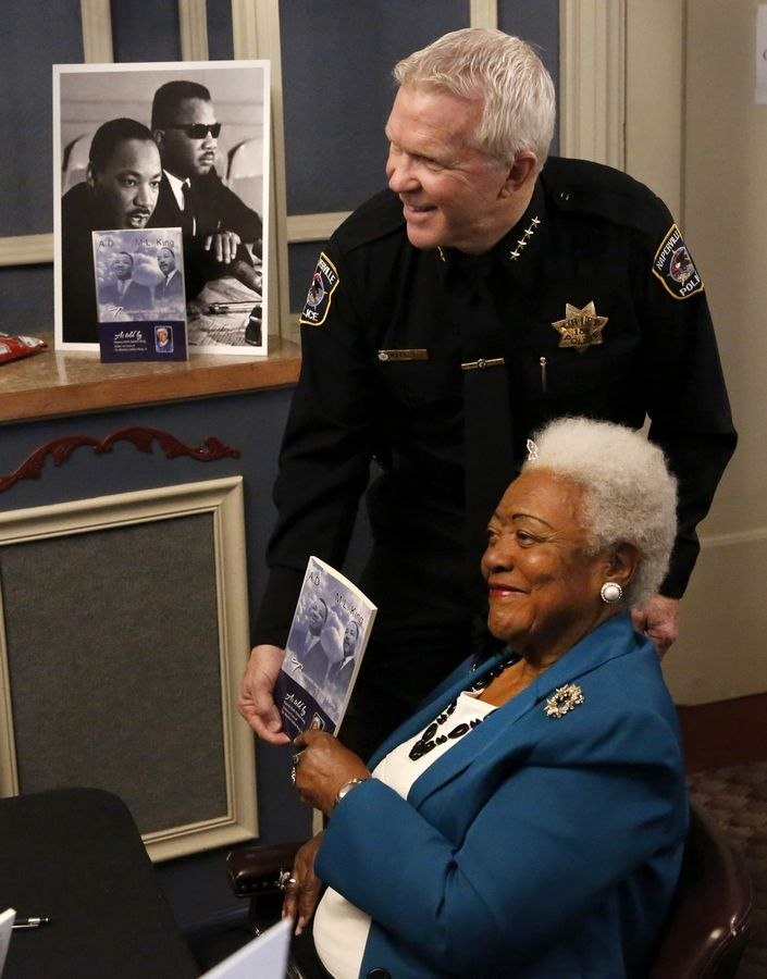 Naomi Ruth Barber King, a civil rights activist and sister-in-law of Rev. Martin Luther King Jr., signed a copy of her book for Naperville police Chief Bob Marshall during an event sponsored by the Unity Partnership at Pfeiffer Hall on the campus of North Central College.