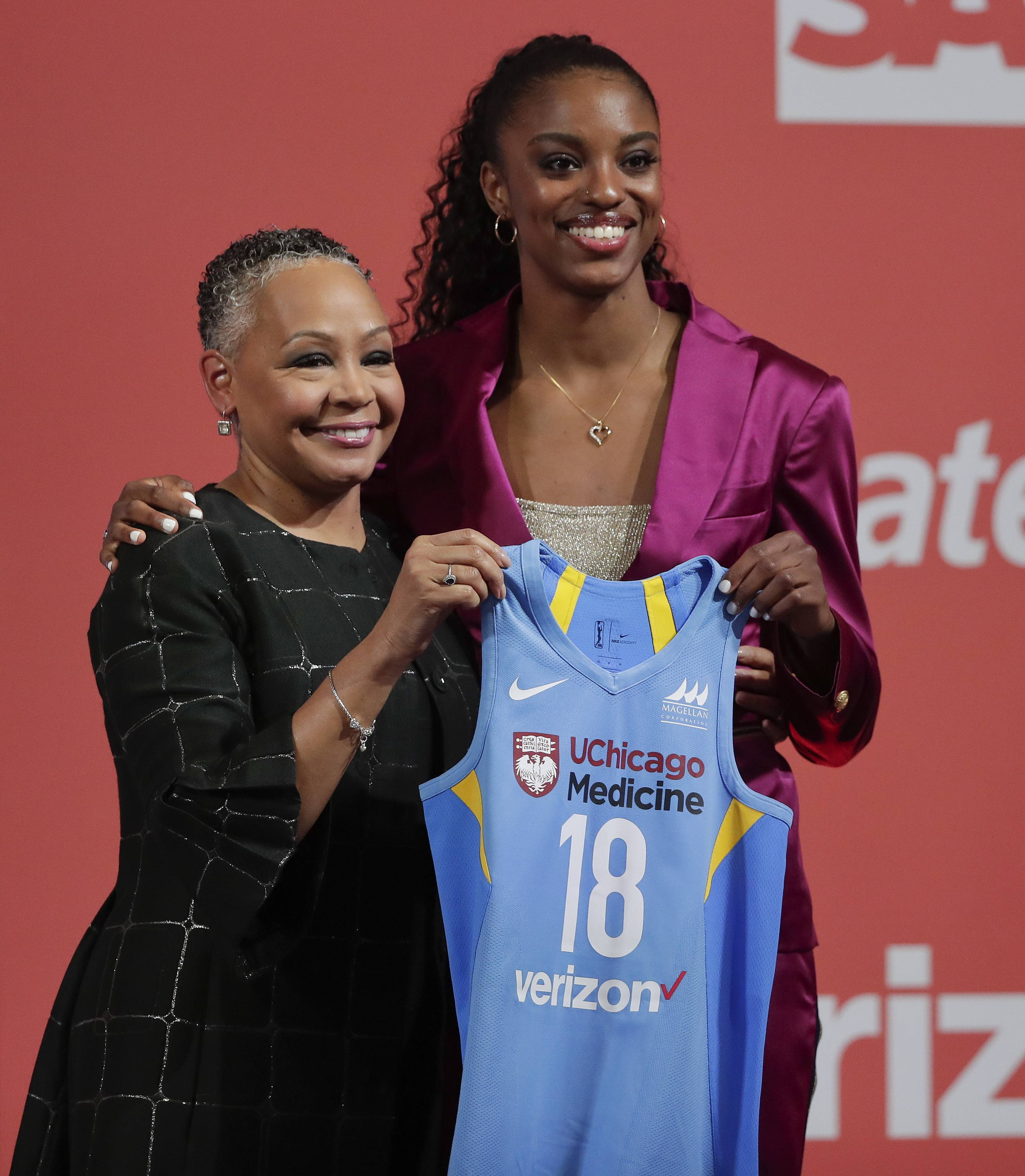 Diamond DeShields, right, poses for a photo with WNBA President Lisa Borders after being selected as the No. 3 pick by the Chicago Sky in the WNBA basketball draft, Thursday, New York.