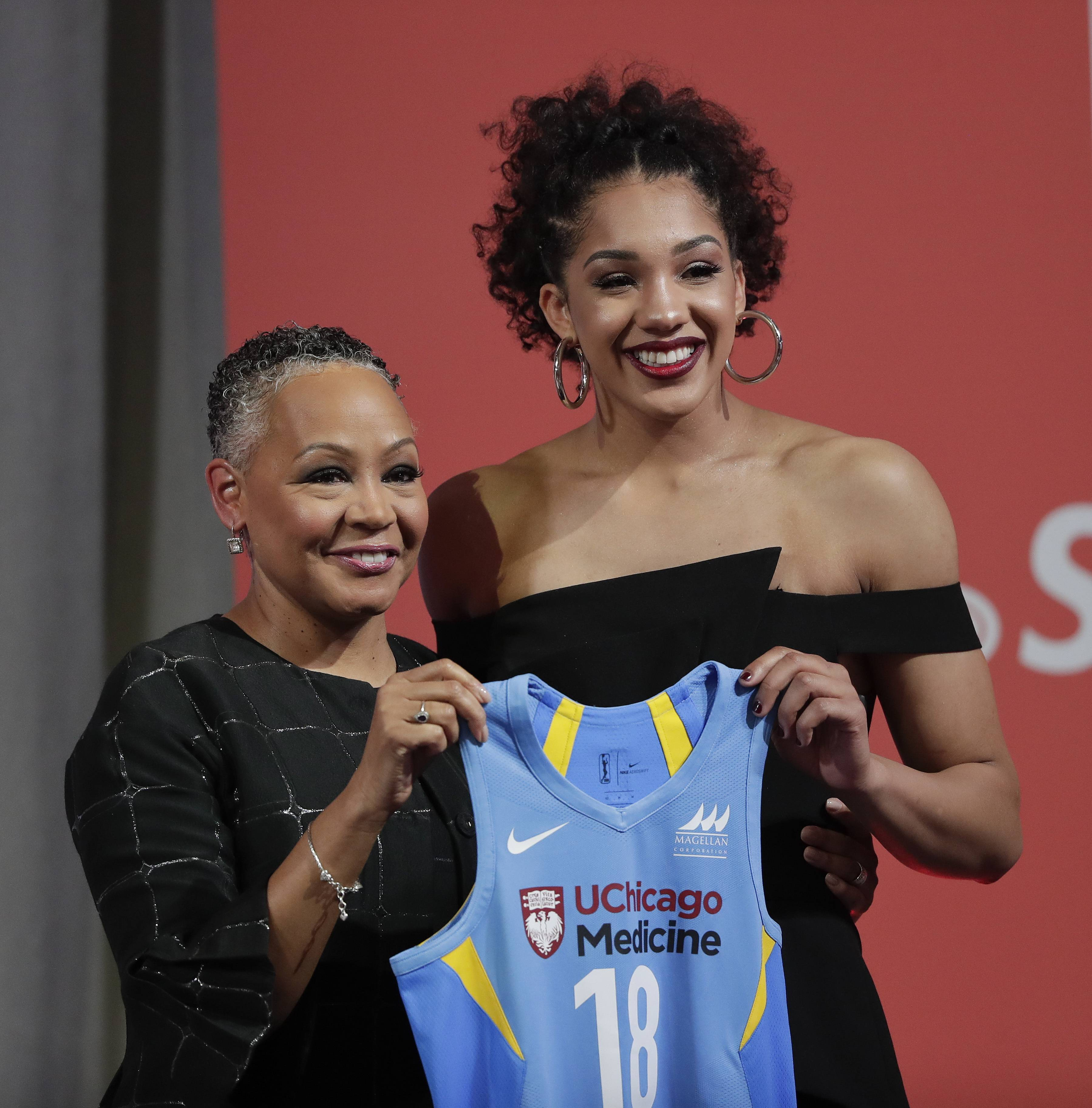 Connecticut's Gabby Williams, right, poses for a photo with WNBA president Lisa Borders after being selected as the No. 4 pick by the Chicago Sky in the WNBA basketball draft, Thursday in New York.