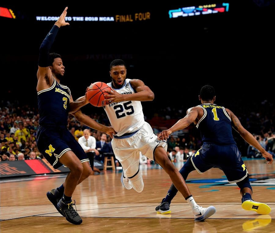 Villanova guard Mikal Bridges drives to the basket between Michigan's Zavier Simpson, left, and Charles Matthews, right, during the second half of the NCAA title game. The Bulls won the draft order tiebreaker with Sacramento, but wherever they pick, Bridges already stands out as a guy who should be at the top of their board.