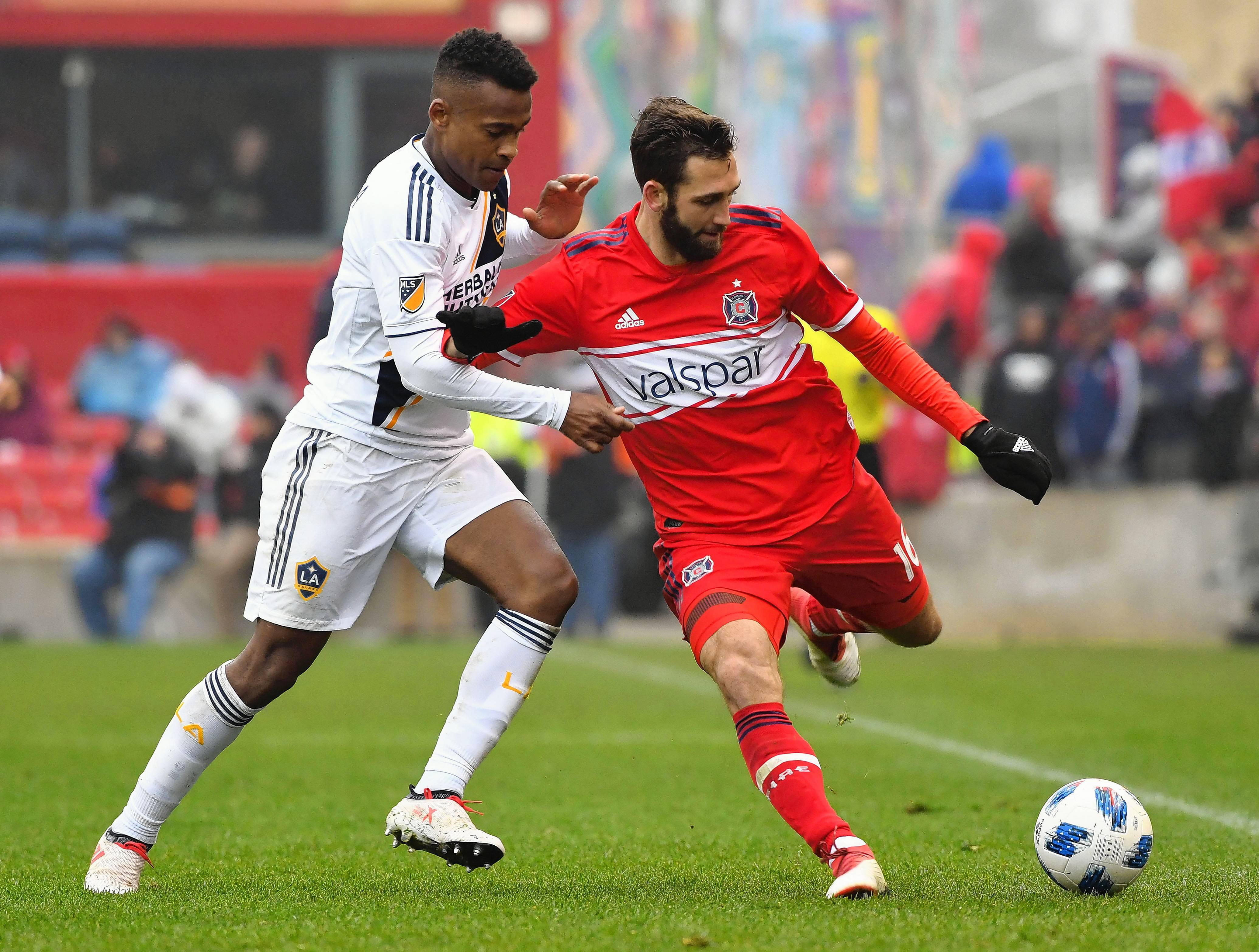 Chicago Fire defender Jonathan Campbell (16) defends against Los Angeles Galaxy forward Ola Kamara (11) during the second half at Bridgeview Stadium on Saturday.