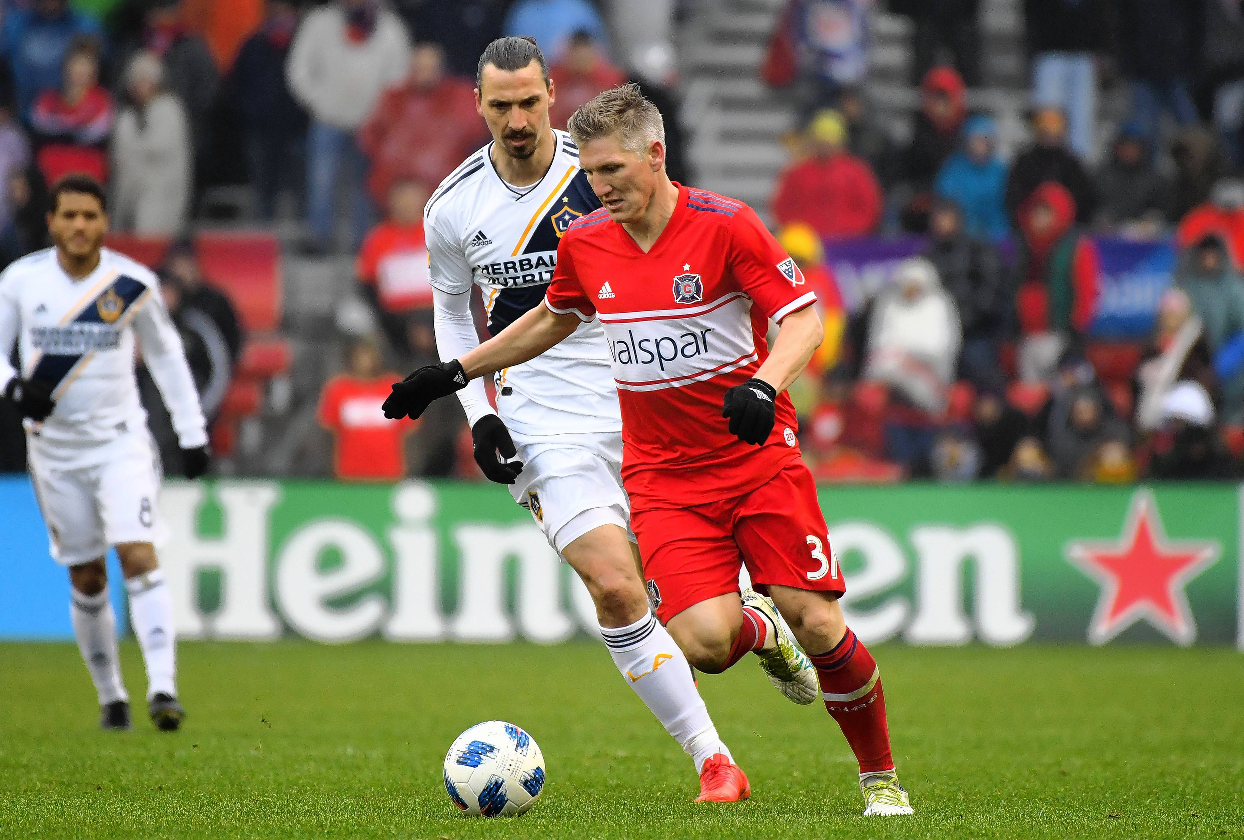 Chicago Fire midfielder Bastian Schweinsteiger (31) kicks the ball away from Los Angeles Galaxy forward Zlatan Ibrahimovic (9) during the second half at Bridgeview Stadium on Saturday.