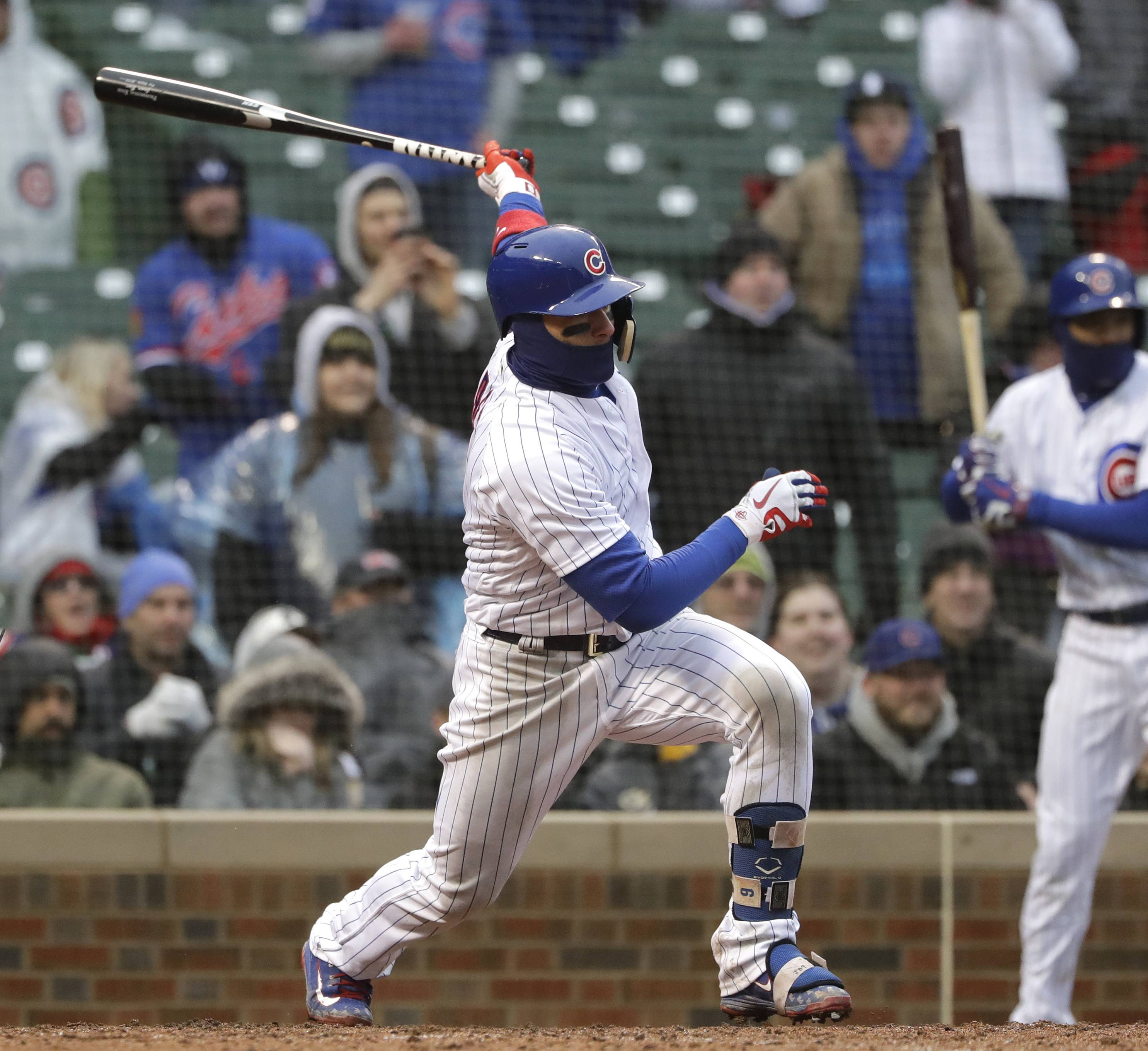 Cubs second baseman Javier Baez watches his 3-run double against the Atlanta Braves in the eighth inning on Saturday at Wrigley Field in Chicago. The Cubs rallied from a 10-2 deficit Saturday, scoring 9 runs in the eighth inning to beat the Atlanta Braves 14-10 at Wrigley Field.