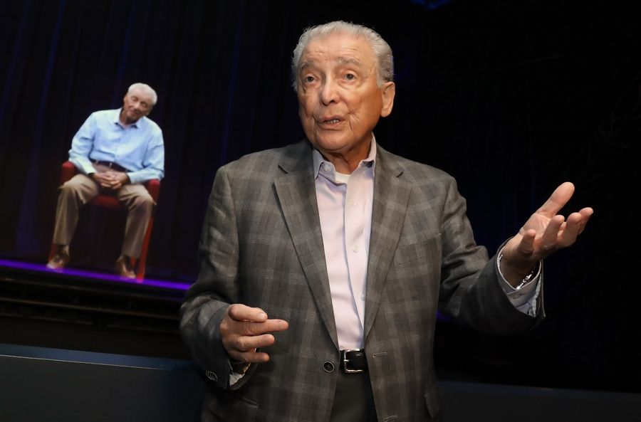Holocaust survivor Aaron Elster of Lincolnshire stands in front of a hologram of himself last October in the new Take A Stand Center at the Illinois Holocaust Museum & Education Center in Skokie. Elster, 86, died Wednesday.