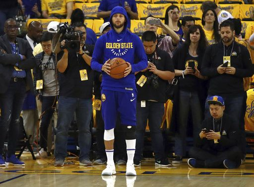 5c74ae0478a2 Golden State Warriors  Stephen Curry warms up prior to Game 1 of a first-