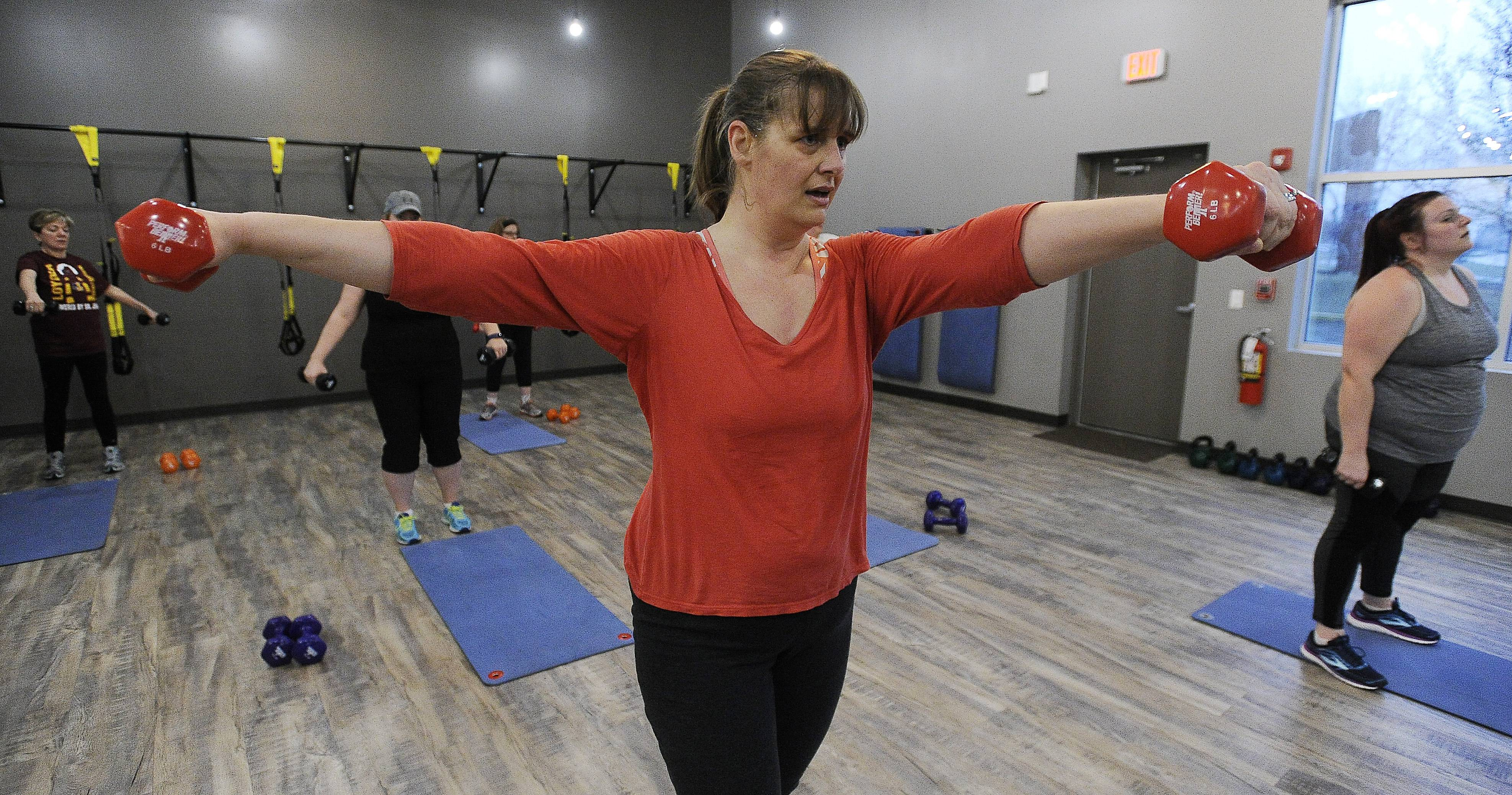 Kirsten Binder of Schaumburg works out at Push Fitness. Michelle Jeeninga, a certified personal trainer at Push Fitness, said getting your workout in bright and early is key to keeping weight off.
