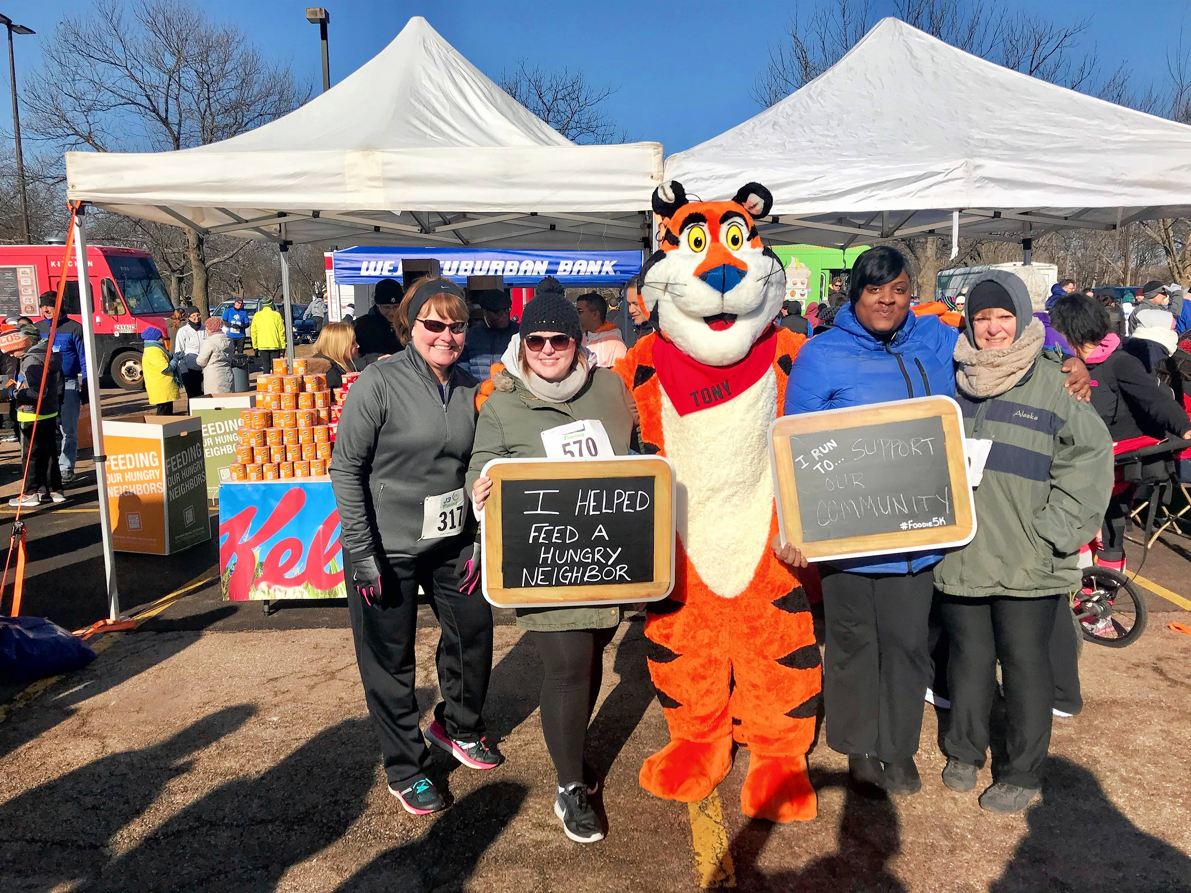 The cold weather didn't stop Marriott Suits Downers Grove and Marriott Oak Brook's Marriott Bod Squad from participating in Northern Illinois Food Bank's Foodie 5K. From left to right, Kristen Duncan, Samantha Jones, Tony the Tiger, Cassandra Johnson, and Katrina Jones.