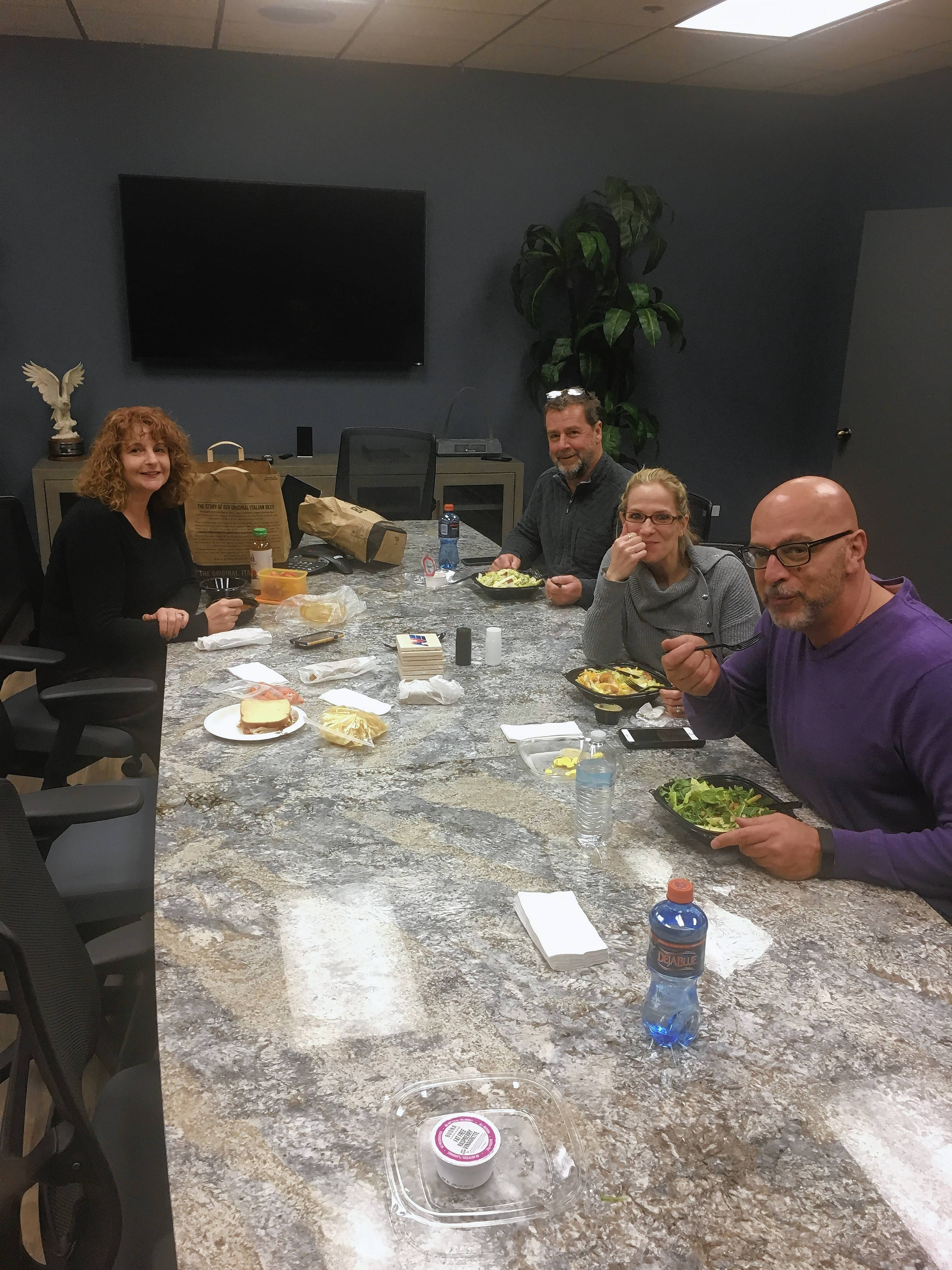 AVS Companies' teams 4 Queens and a Joker and Lotsa Guts have switched from eating fast food for lunch to having healthy, home cooked meals and salads. From left to right, Eileen Schreiner, Vince Gumma, Michelle Lopez and Tony Shamma