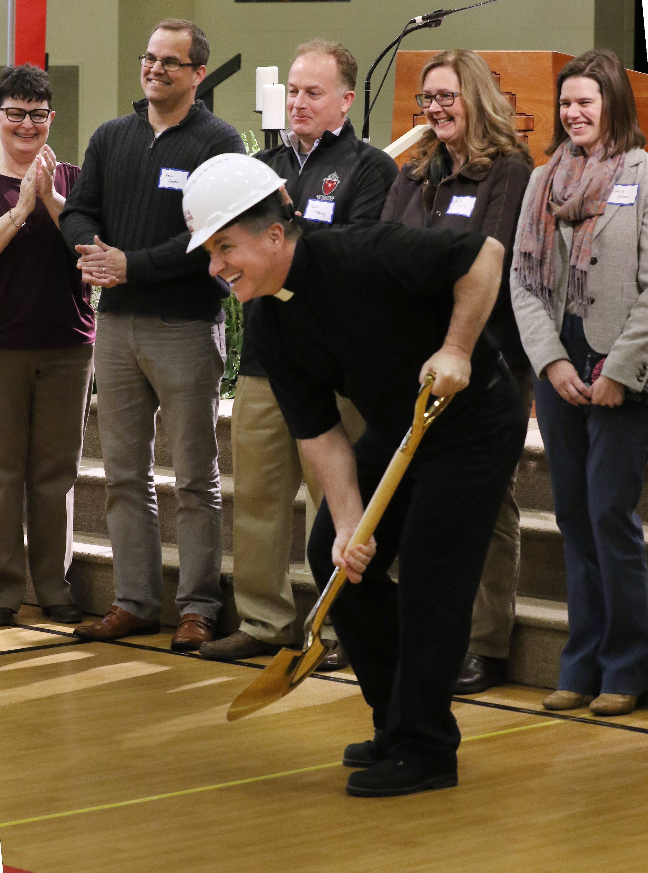 The Rev. Matt Foley pretends to dig Sunday during a groundbreaking and blessing ceremony at St. James Catholic Church in Arlington Heights. The ceremony officially kicked off a long-awaited, $10.5 million expansion of the church.