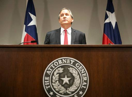 "FILE - In this May 25, 2016 file photo, Republican Texas Attorney General Ken Paxton announces the state's lawsuit to challenge President Barack Obama's transgender bathroom order during a news conference in Austin, Texas. Many GOP attorneys general have urged President Donald Trump's 2020 census team to add a citizenship question. ""We always are better off having a more accurate count of citizens versus non-citizens. I see no downside in this,"" says Paxton, vice chairman of the Republican Attorneys General Association. (Jay Janner/Austin American-Statesman via AP)"