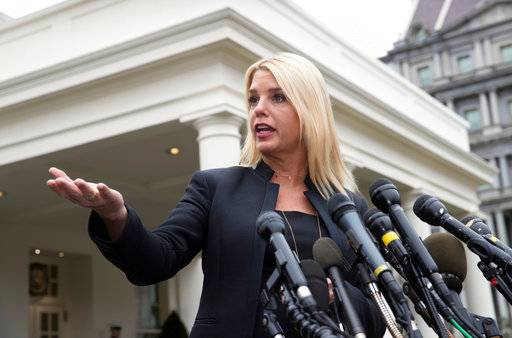 FILE - In this Thursday, Feb. 22, 2018 file photo, Florida Attorney General Pam Bondi speaks to reporters outside the West Wing about about responses to school shootings like the attack in Parkland, Fla., in Washington, after a meeting on student safety with President Donald Trump at the White House in Washington. Bondi is among 11 Republican state attorneys general and two governors who signed a March 13, 2018 letter urging the Commerce Department to include a citizenship question on the 2020 census.