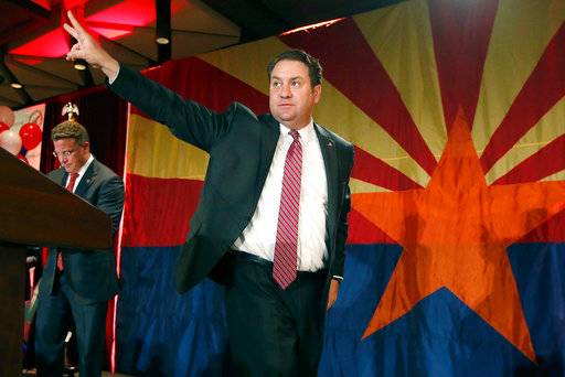 "FILE - In this Nov. 4, 2014 file photo, Arizona Republican Attorney General Mark Brnovich waves to supporters at the Republican election night party in Phoenix. Minority Democrats in the Arizona Legislature have urged Brnovich to join the lawsuit challenging the citizenship question in the 2020 census. But his spokesman said that won't happen, just as he refused to sign onto the Republican letter urging the question be included in the census. ""We have concerns this issue has been overly politicized,� Brnovich spokesman Ryan Anderson said in a statement."