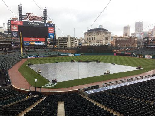 The field is covered as the Yankees and Tigers were rained out Saturday, April 14, 2018 in Detroit.  The Yankees beat the Tigers 8-6 on Friday night, and the teams will try to play a split doubleheader Sunday to finish this three-game series - but the weather then might not be any better.
