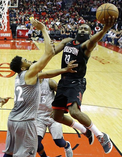 d4363c3898d0 Houston Rockets  James Harden shoots over Minnesota Timberwolves   Karl-Anthony Towns during the