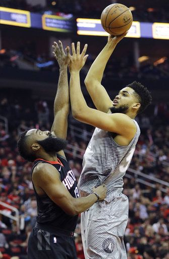 ba09f45d9604 Minnesota Timberwolves  Karl-Anthony Towns shoots over Houston Rockets   James Harden during the