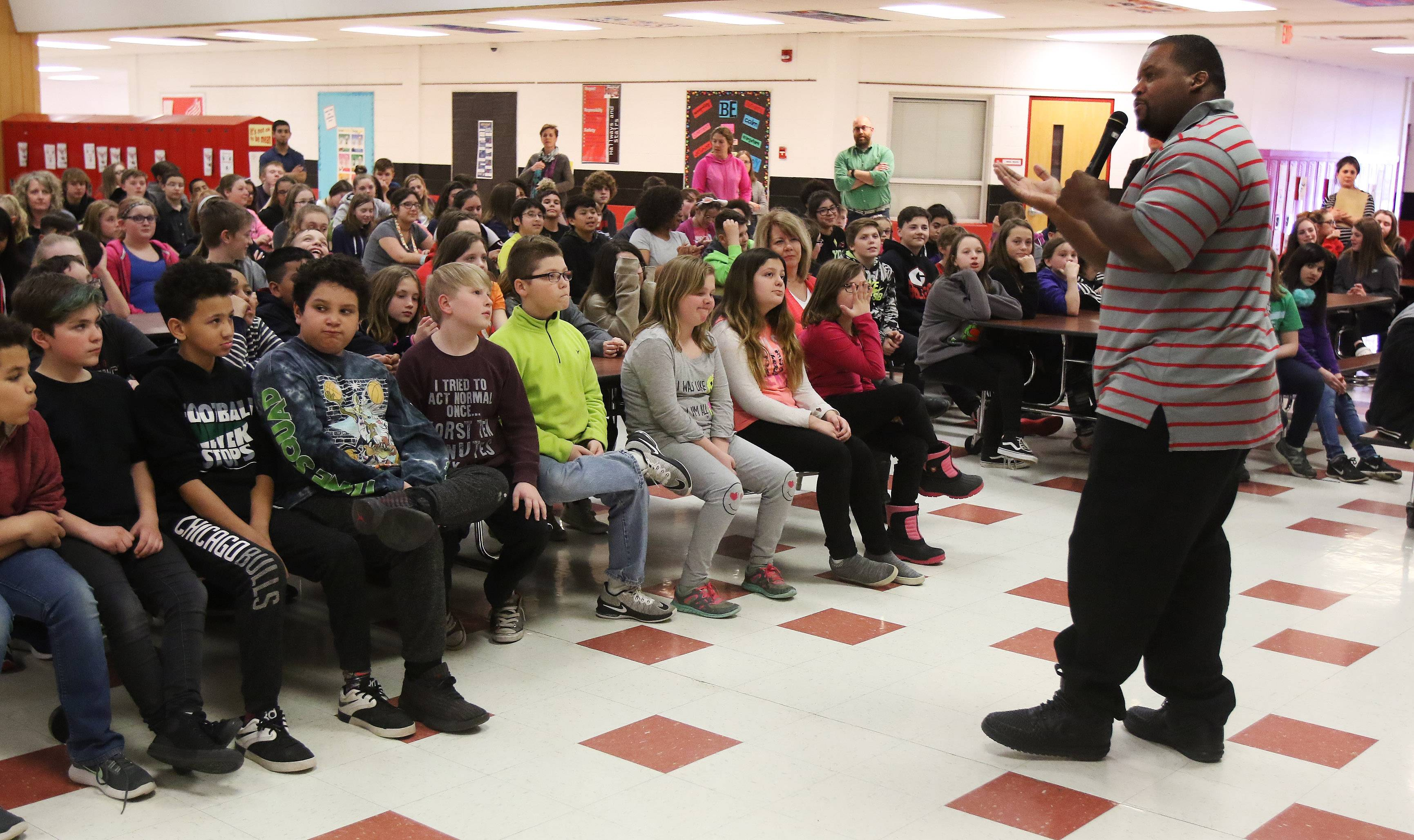 "Former Chicago Bear Anthony ""Spice"" Adams talks to students about making good choices Monday during an appearance at Stanton School in Fox Lake. More than 300 fifth-through-eighth grade students heard Adams' presentations."