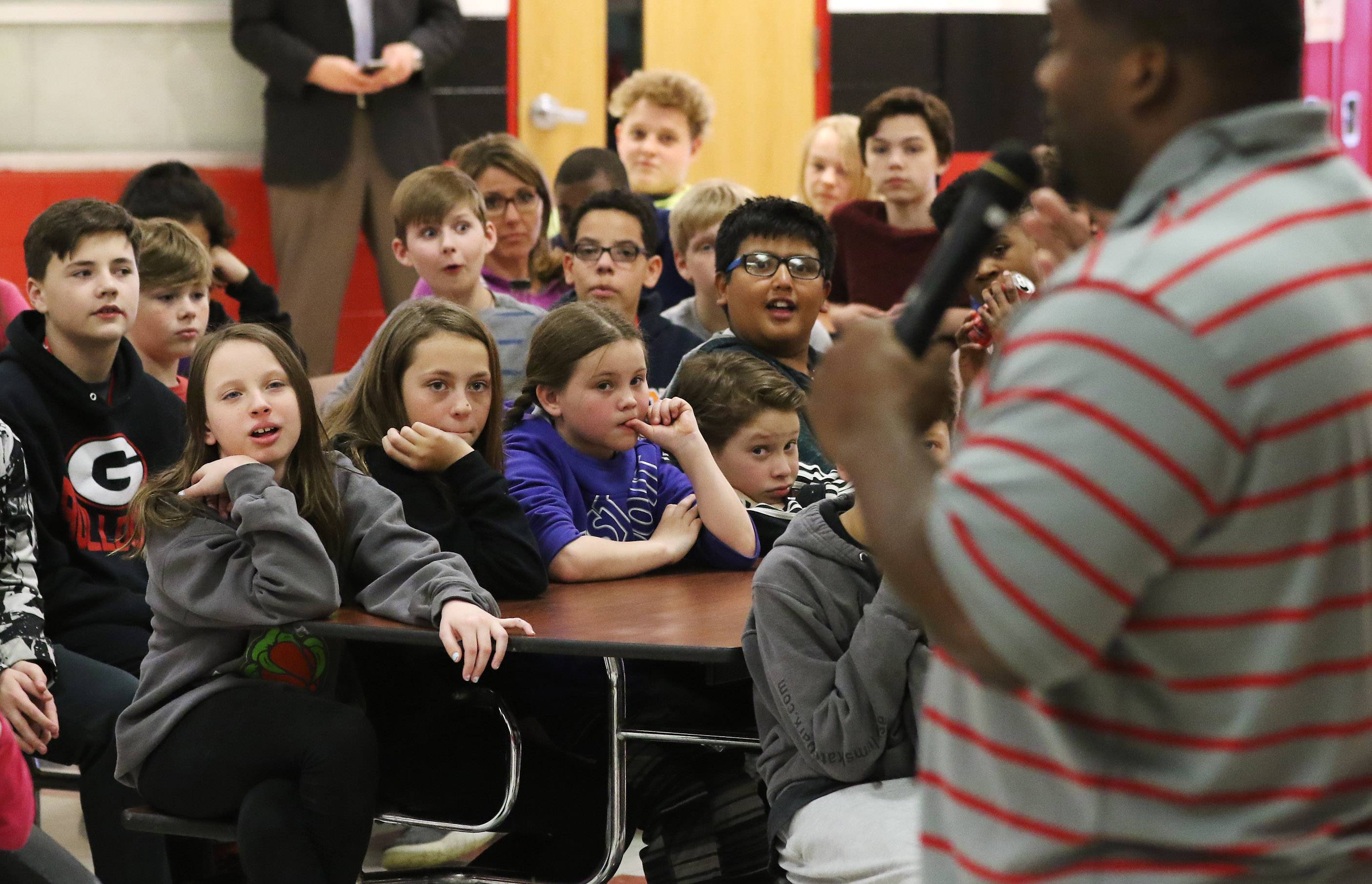 "Former Chicago Bear Anthony ""Spice"" Adams talks with students Monday at Stanton School in Fox Lake. Adams stressed making good choices and always having a Plan B. Adams, who played for the Bears for five years, talked about making good choices, peer pressure, and his life on and off the field."