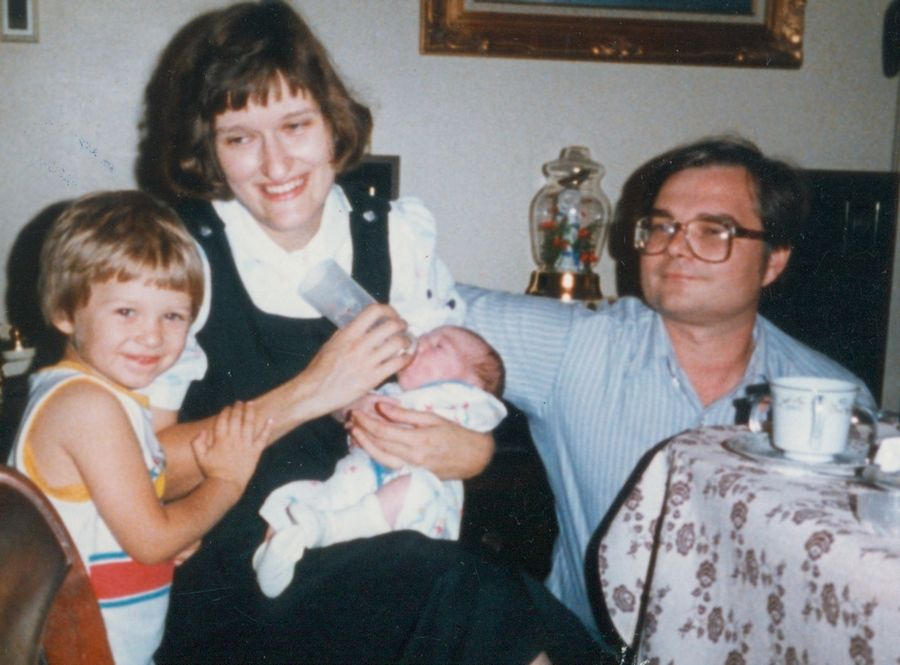 With oldest son Nicholas at her side, Janice Such feeds baby Danny while Joe Such looks on shortly after Danny's birth in 1985.