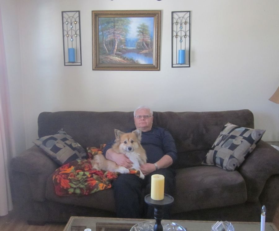 Joe Such with his corgi Fiona in his Elk Grove Village living room in February 2014.