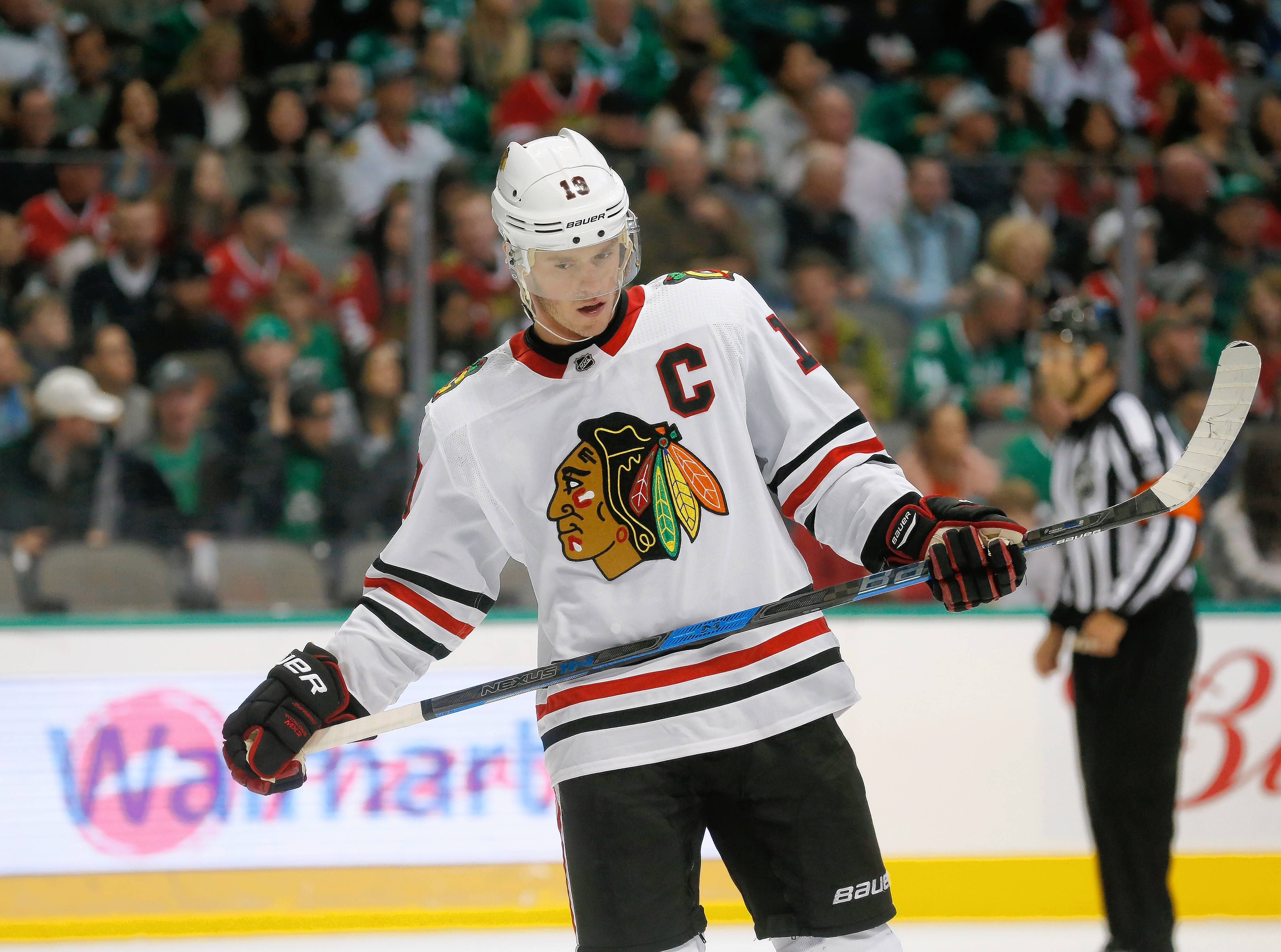 Chicago Blackhawks center Jonathan Toews (19) prepares for a face-off against the Dallas Stars during the first period of an NHL hockey game in Dallas, Thursday, Dec. 21, 2017.