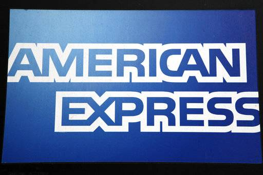 FILE - This Jan. 21, 2015, file photo, shows a sign for American Express outside a New York business. American Express is ending its frequent-shopper program Plenti, despite years of marketing and high-profile partners like RiteAid, ExxonMobil and Macy's. The Plenti program will end on July 10, 2018, the company announced in a tweet Monday, April 16.
