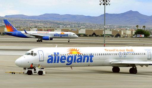 "File - In this May 9, 2013, file photo, two Allegiant Air jets taxi at McCarran International Airport in Las Vegas. Shares of Allegiant Air's parent company are tumbling in Monday, April 16, 2018, premarket trading following a ""60 Minutes� investigation that expressed serious safety concerns about the airline."