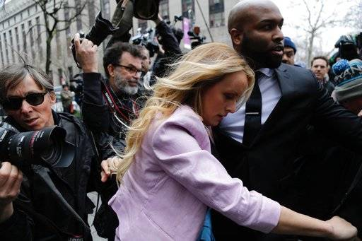 Porn actress Stormy Daniels arrives at federal court, Monday, April 16, 2018, in New York. A U.S. judge will hear more arguments about President Donald Trump's extraordinary request that he be allowed to review records seized from his lawyer, Michael Cohen, office as part of a criminal investigation before they are examined by prosecutors. The raid carried out last Monday at Cohen's apartment, hotel room, office and safety deposit box sought bank records, records on Cohen's dealing in the taxi industry, Cohen's communications with the Trump campaign and information on payments made in 2016 to former Playboy model Karen McDougal and to Daniels.