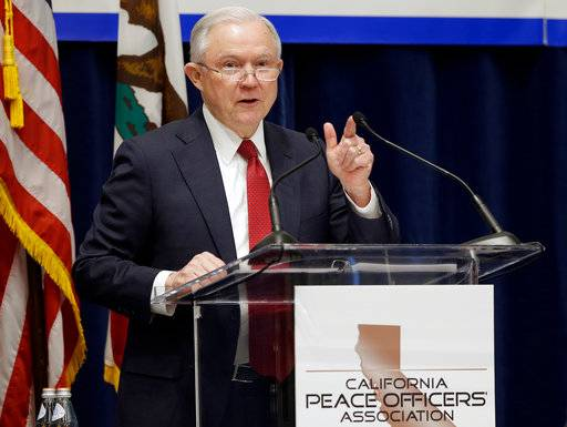 "FILE - In this March 7, 2018, file photo, U.S. Attorney General Jeff Sessions addresses the California Peace Officers' Association at the 26th Annual Law Enforcement Legislative Day in Sacramento, Calif. Since the Sessions-led Department of Justice sued California last month over its so-called ""sanctuary state� law limiting police collaboration with immigration agents, at least a dozen local governments have voted to either join or support the lawsuit or for resolutions opposing the state's position."