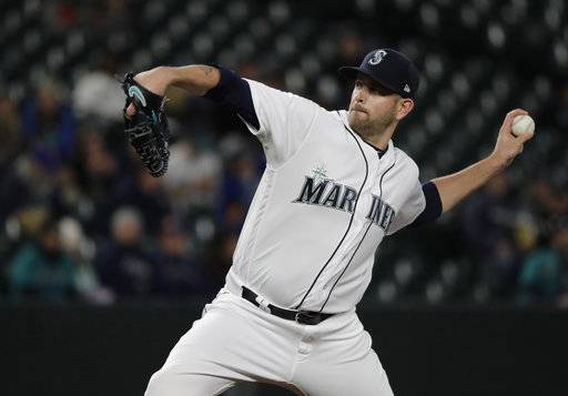 Seattle Mariners starting pitcher James Paxton throws against the Houston Astros in the first inning of a baseball game, Monday, April 16, 2018, in Seattle.