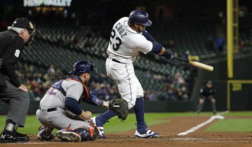 Seattle Mariners' Nelson Cruz hits a solo home run against the Houston Astros in the fourth inning of a baseball game, Monday, April 16, 2018, in Seattle.