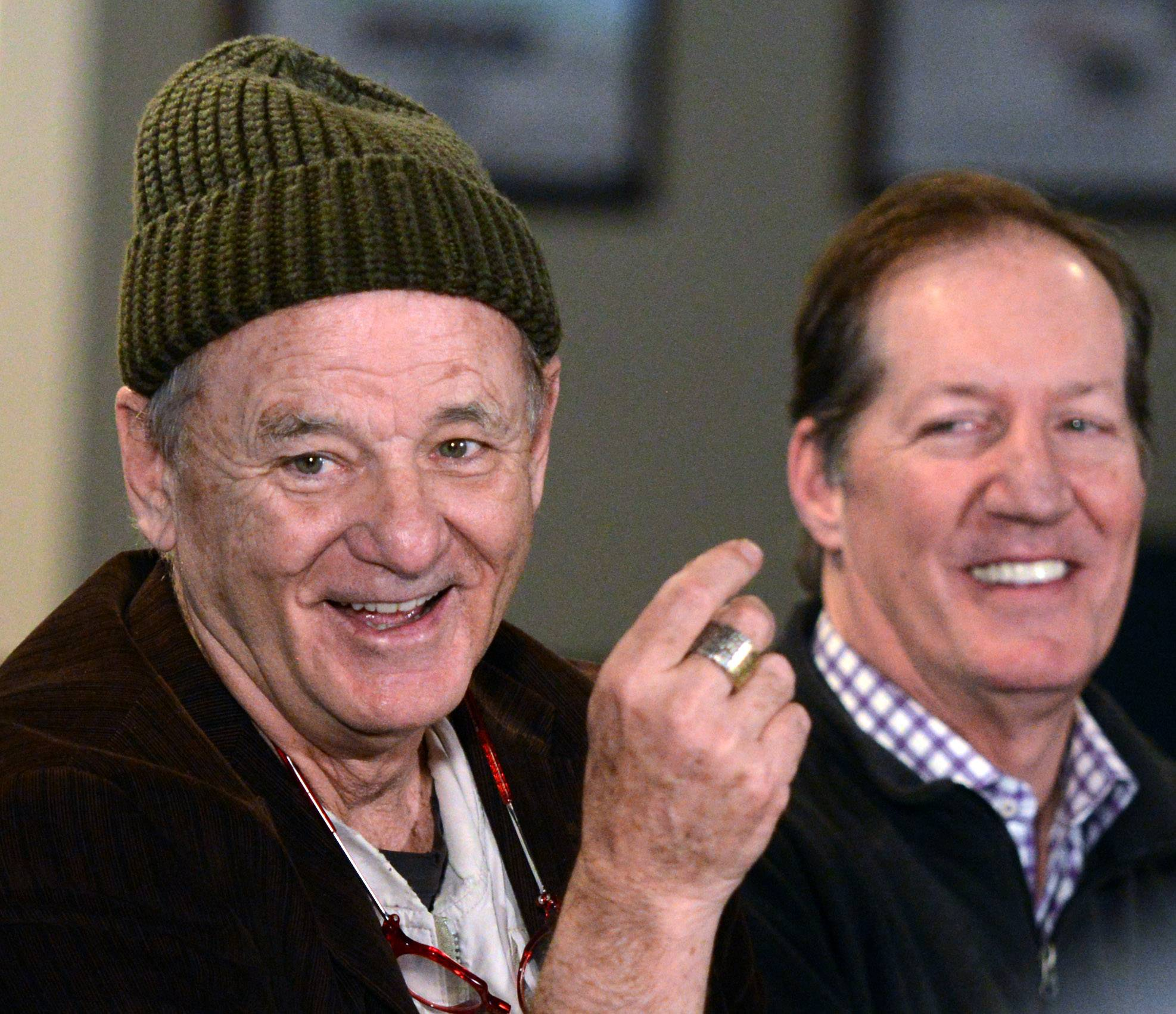 Bill Murray helps open his family's new 8,600-square-foot Murray Bros. Caddyshack sports bar in Rosemont onTuesday. Bar CEO Mac Haskell is at right.