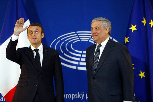 French President Emmanuel Macron, left, is welcomed by European Parliament president Antonio Tajani upon his arrival at the European Parliament in Strasbourg, eastern France, Tuesday, April 17, 2018. In his speech to European lawmakers Tuesday in Strasbourg, France, Macron will launch a drive to seek European citizens' opinions on the European Union's future.