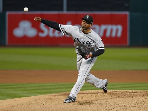 Chicago White Sox starting pitcher Reynaldo Lopez (40) works against the Oakland Athletics during the first inning of a baseball game Monday, April 16, 2018, in Oakland, Calif.