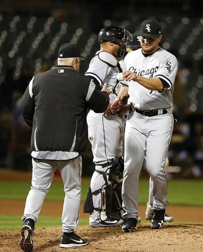 Chicago White Sox relief pitcher Luis Avilan (70) is taken out by manager Rick Renteria, left, during the seventh inning against the Oakland Athletics in a baseball game, Monday, April 16, 2018, in Oakland, Calif.