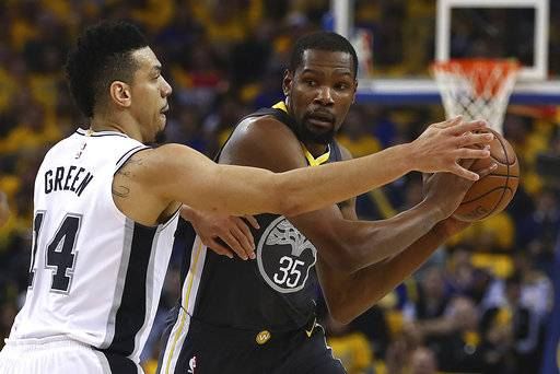 Golden State Warriors' Kevin Durant (35) is guarded by San Antonio Spurs' Danny Green (14) during the first quarter in Game 2 of a first-round NBA basketball playoff series Monday, April 16, 2018, in Oakland, Calif.