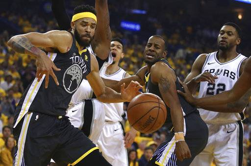 Golden State Warriors' JaVale McGee, left, and Andre Iguodala watch a loose ball beside San Antonio Spurs' Rudy Gay (22) during the first quarter in Game 2 of a first-round NBA basketball playoff series Monday, April 16, 2018, in Oakland, Calif.