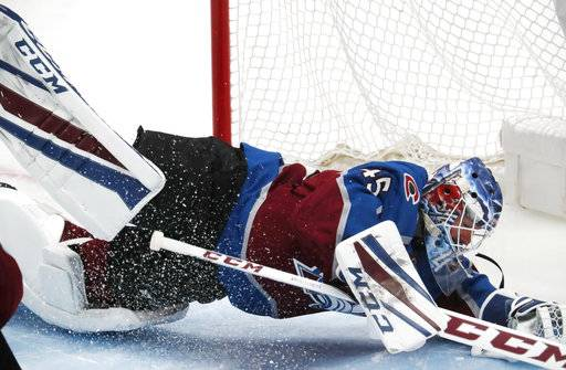 Colorado Avalanche goaltender Jonathan Bernier dives but misses a shot that goes in for a goal by Nashville Predators center Colton Sissons in the third period of Game 3 of an NHL hockey first-round playoff series, Monday, April 16, 2018, in Denver. Colorado won 5-3.