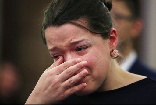 "Amelia Tramontano, wipes away her tears as she listens to testimonies from athletes who were victims of sexual assault during a Commerce, Science, and Transportation: Subcommittee on Consumer Protection, Product Safety, Insurance, and Data Security hearing about ""Olympic abuse: The role of national governing bodies in protecting our athletes"" on Capitol Hill in Washington, Wednesday, April 18, 2018. Tramontano who is not an athlete was sexually assaulted when she was a teenager."