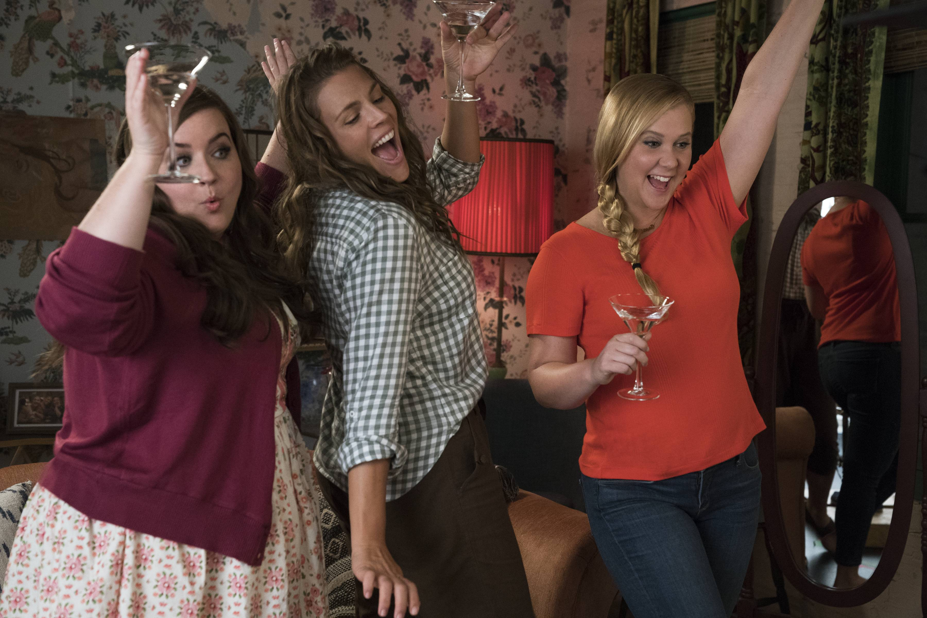 "Renee (Amy Schumer), right, enjoys time with her best buds (Aidy Bryant, left, and Busy Philipps) in ""I Feel Pretty."""