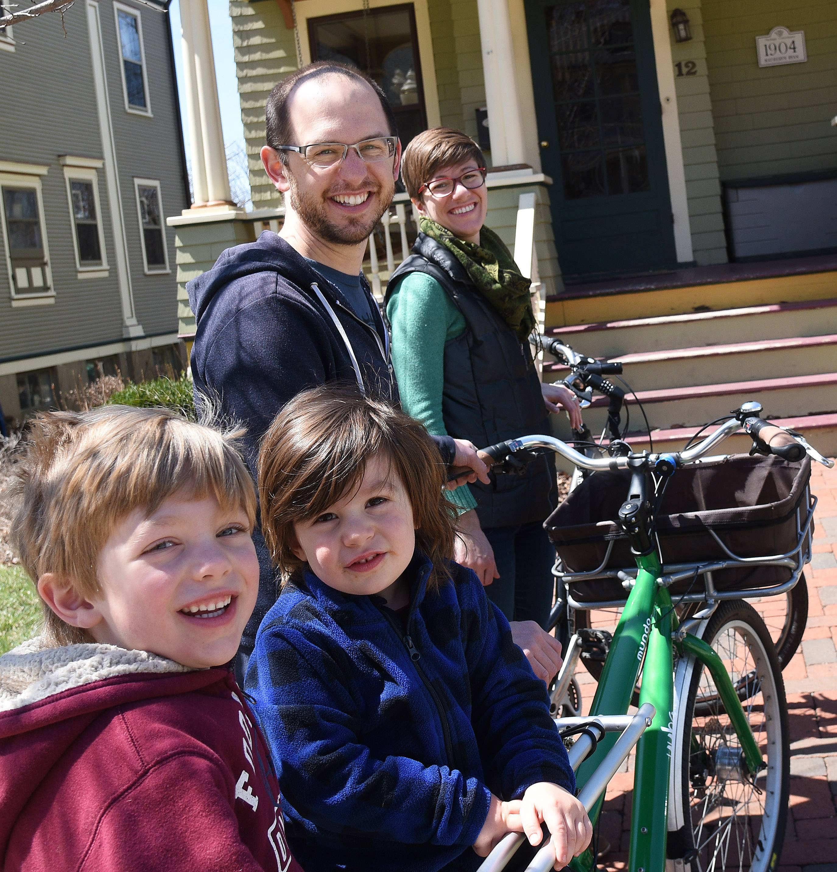 "Elgin Bike Hub is a community project by the Thompson family that encourages people to bike around Elgin with ""fun, social rides to explore our neighborhoods."" Parker and Katie are pictured with sons Noam, 5, left, and Gabriel, 3."