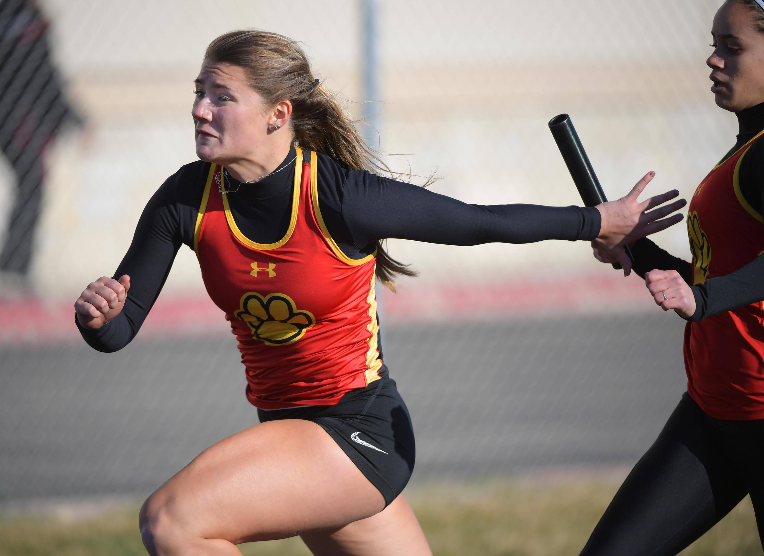 Batavia's Sabrina Schlenker reaches for the baton from teammate Davinia Wilson in the first exchange of the 400-meter relay Thursday at the Batavia girls track invitational.