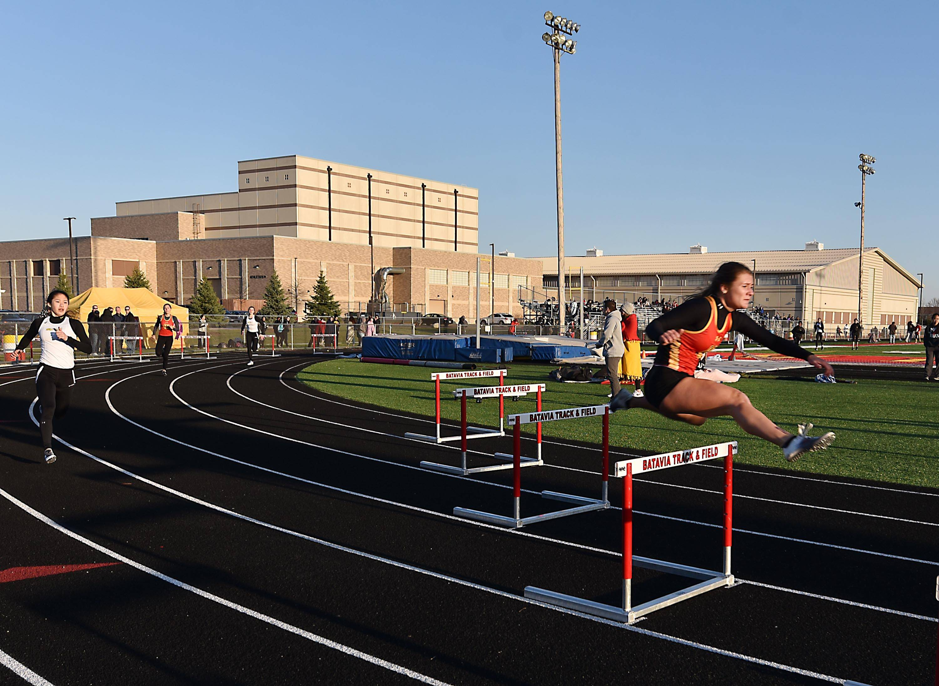 Batavia's Sabrina Schlenker leads the 300-meter hurdles Thursday at the Batavia girls track invitational.