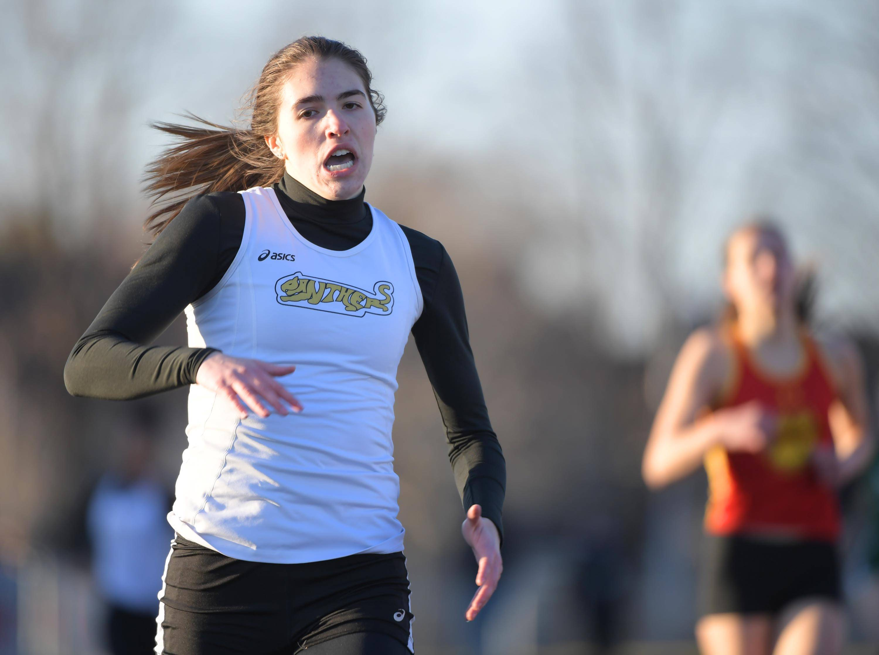 Glenbard North's Akria Lebron wins the 400-meter dash Thursday at the Batavia girls track invitational.