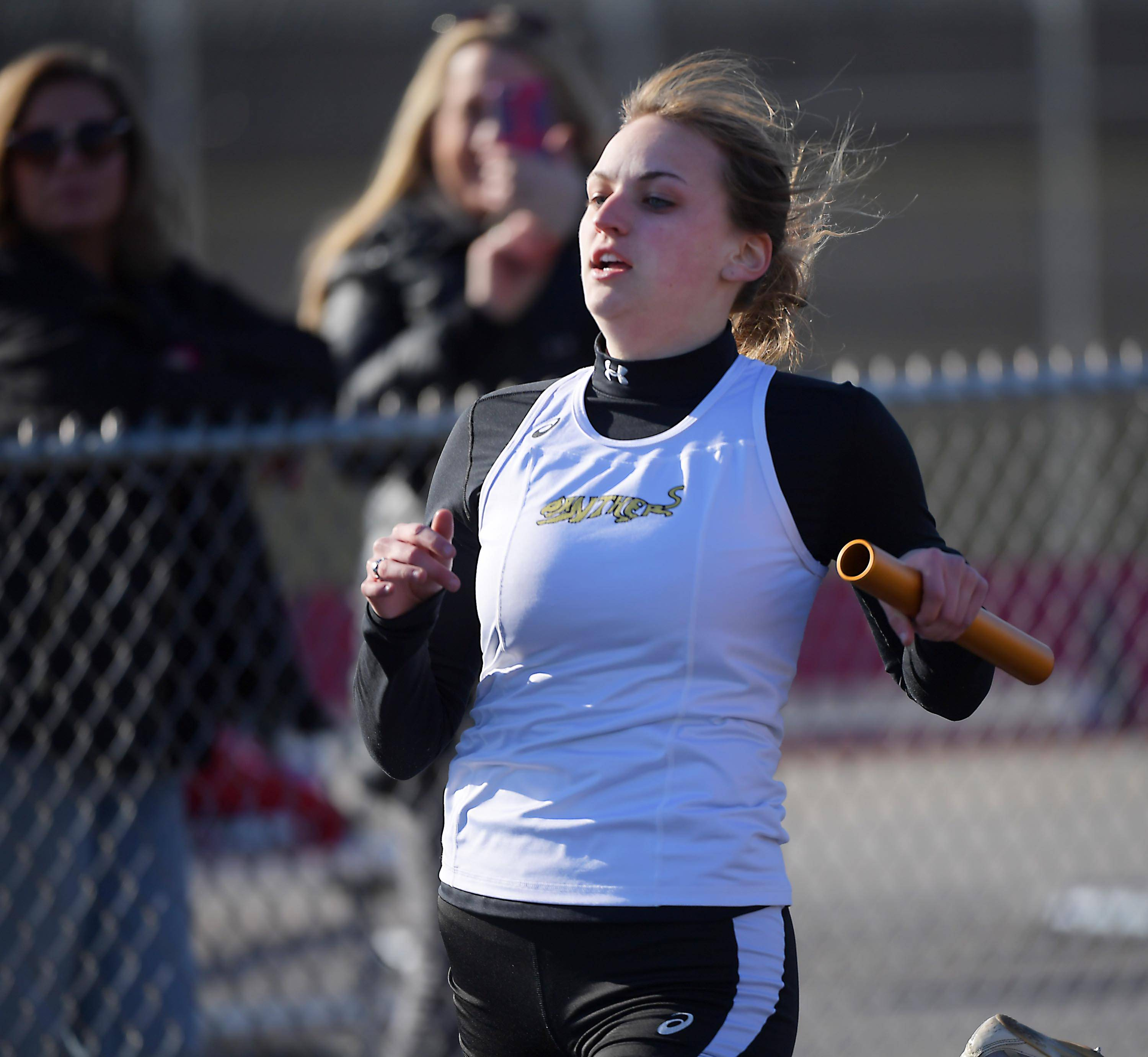 Glenbard North's Lauren Mahoney crosses the finish line as the anchor leg of the 400-meter relay team Thursday at the Batavia girls track invitational.