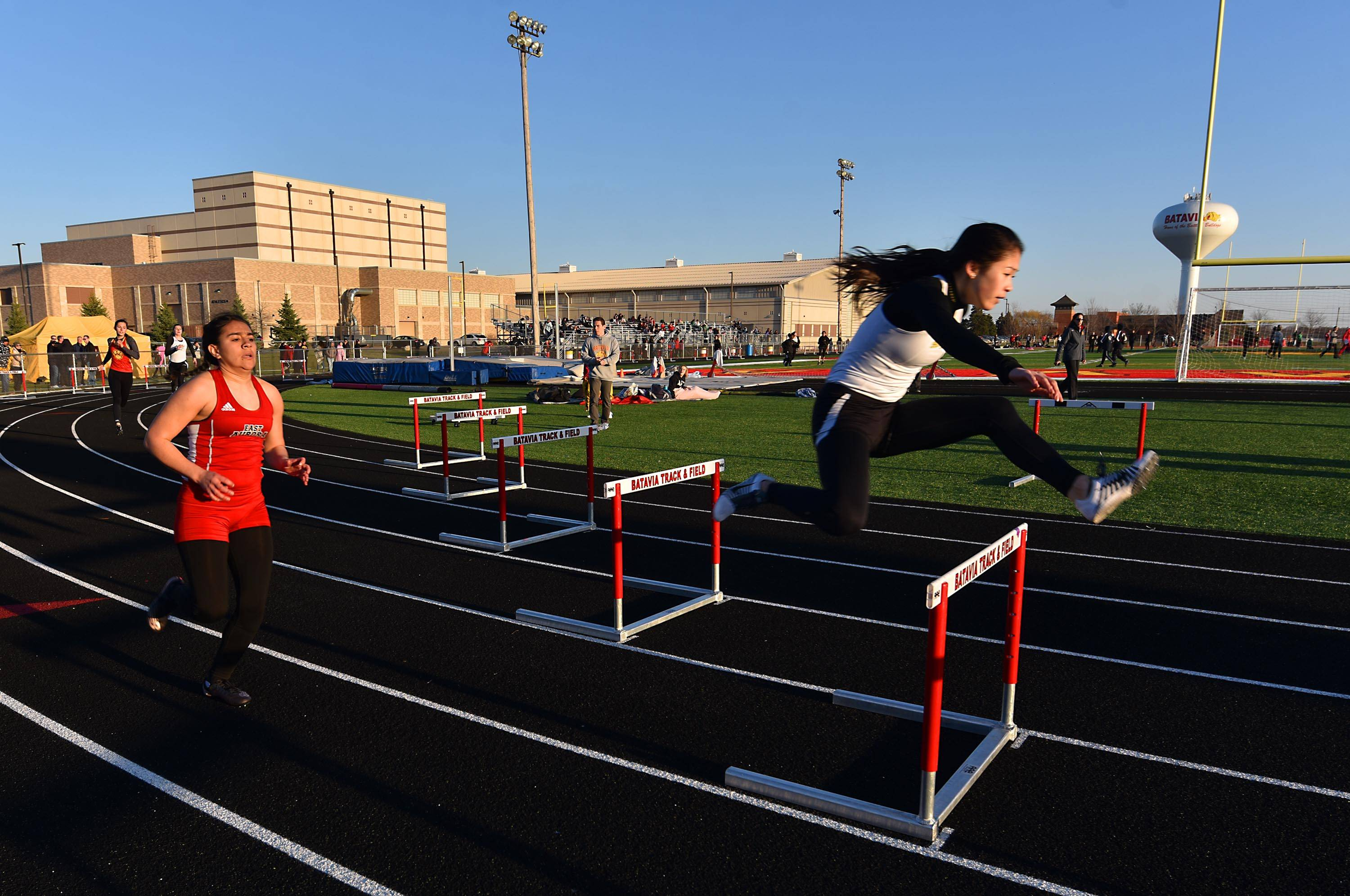 Glenbard North's Brenda Nguyen competes in the 300-meter hurdles Thursday at the Batavia girls track invitational.