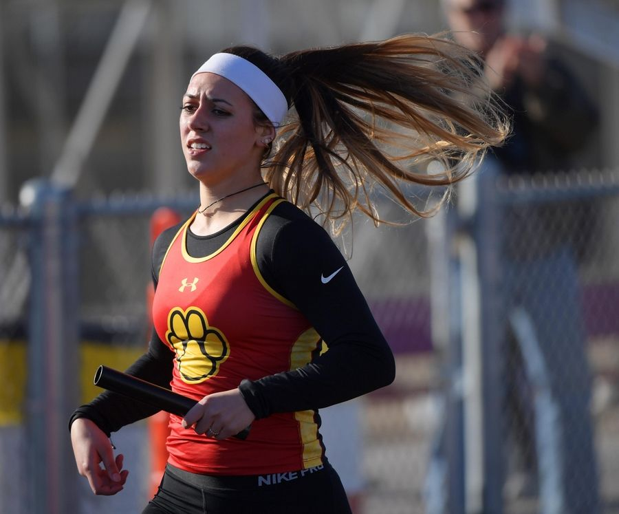 Batavia's Tori Ortiz crosses the finish line as the anchor of the 400-meter relay team Thursday at the Batavia girls track invitational.